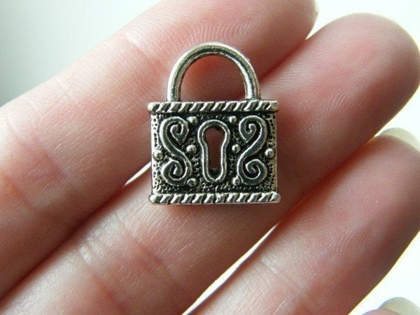 4 Lock pendants  antique silver tone K12