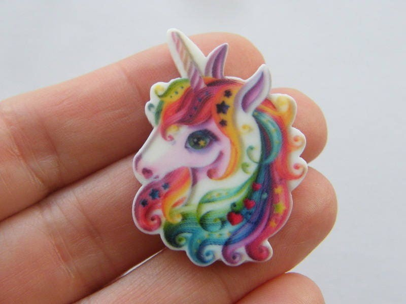 4 Unicorn embellishments resin  A829