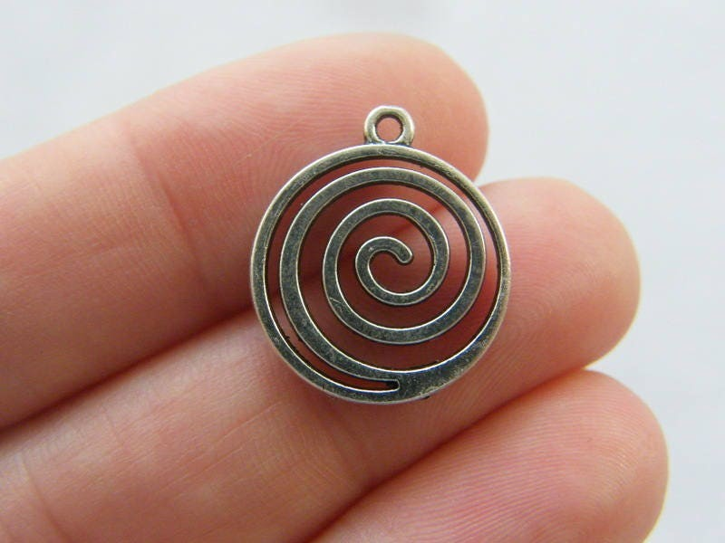 6 Spiral pattern charms antique silver tone FM166