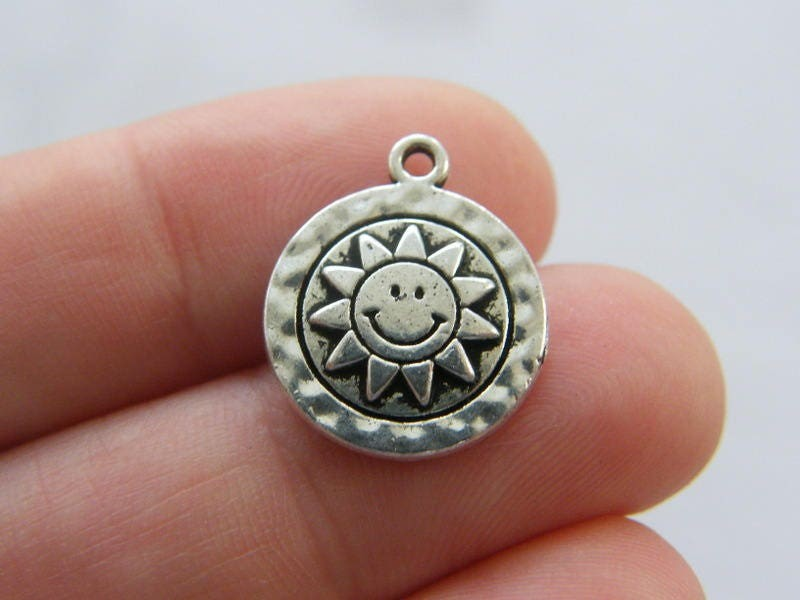8 Sun charms antique silver tone S158