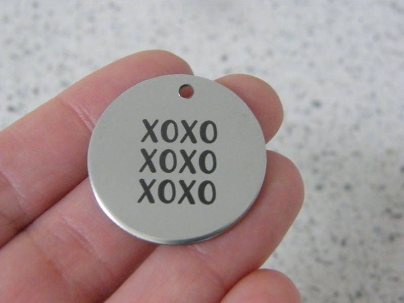 1 XOXO stainless steel pendant JS4-40