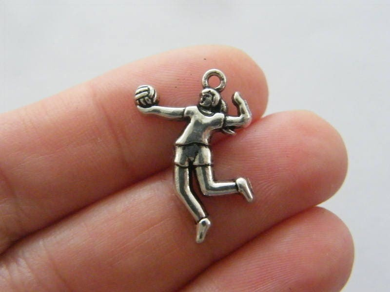 4 Volleyball player charms antique silver tone SP163