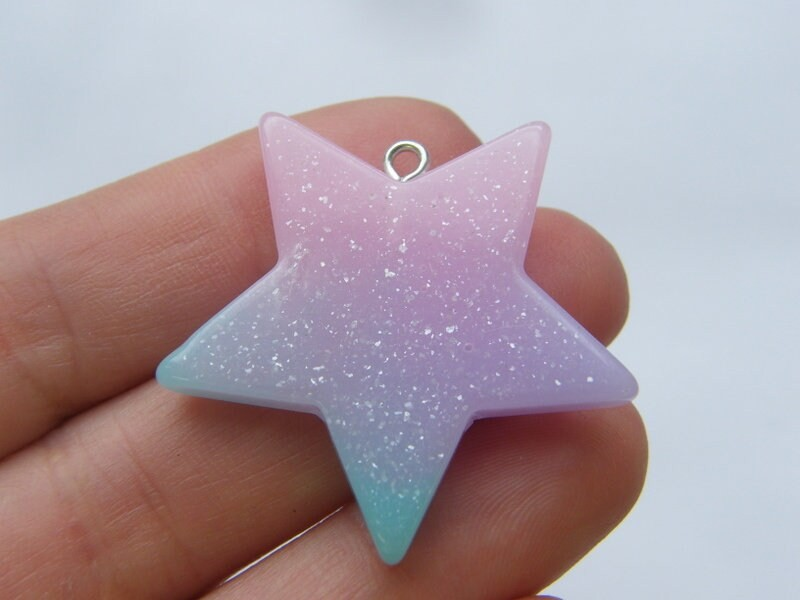 2 Star glittery mixed resin pendants S154