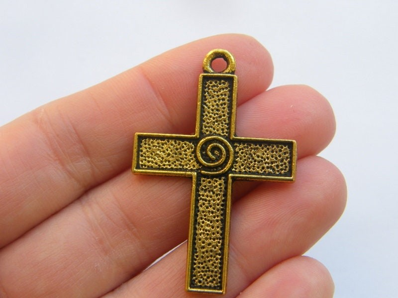 4 Cross charms antique gold tone GC530