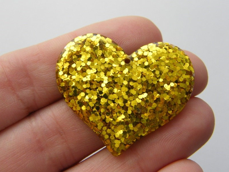 4 Heart glittery gold resin pendants H217