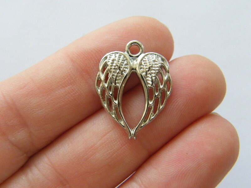 8 Angel wing charms silver tone AW194