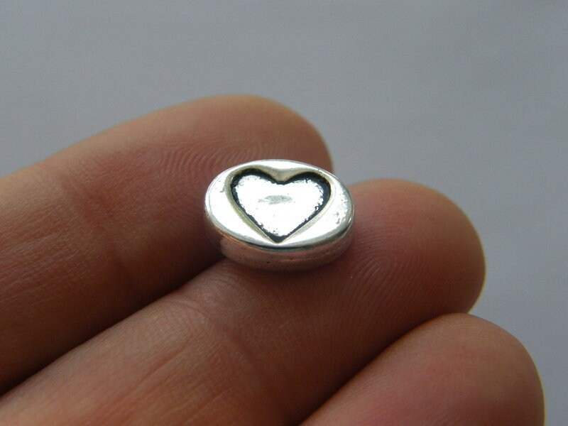 10 Heart spacer beads antique silver tone H225