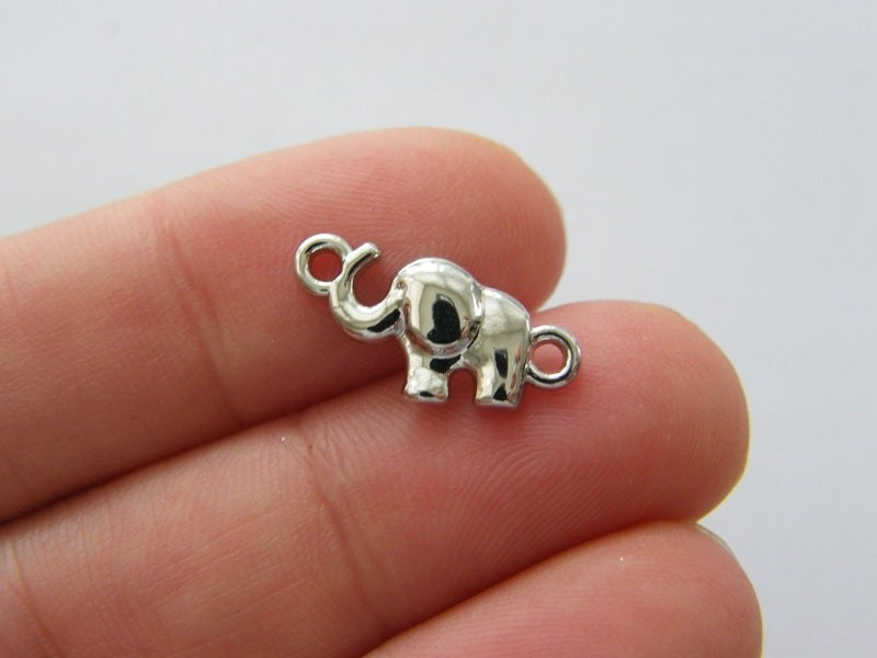 8 Elephant connector charms silver tone A997