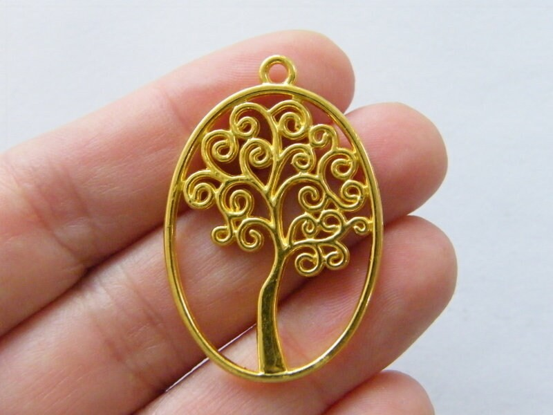 4 Tree pendants gold tone GC55
