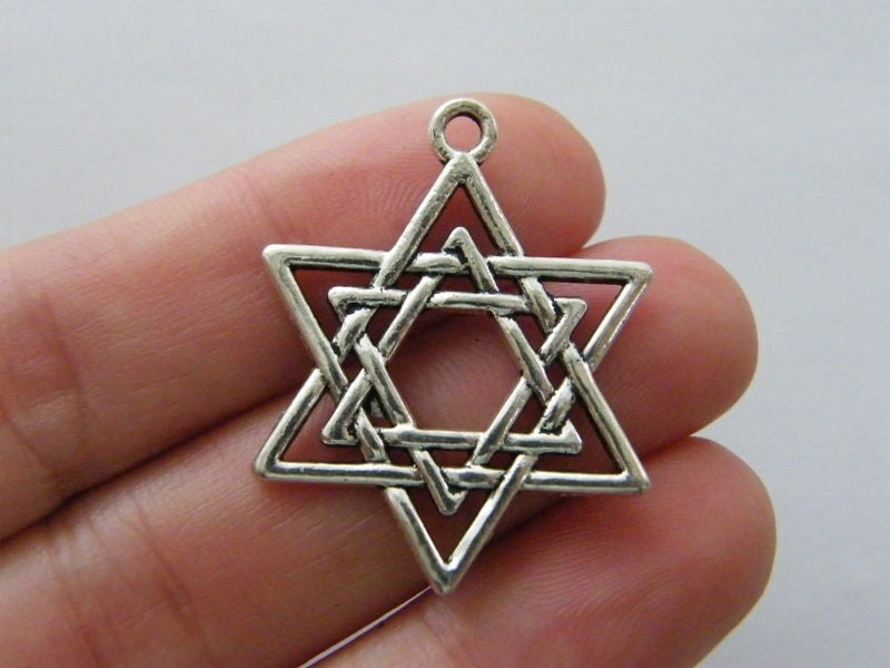 4 Star of David pendants silver tone R170