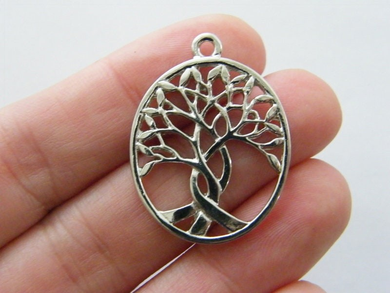 4 Tree pendants silver tone T130