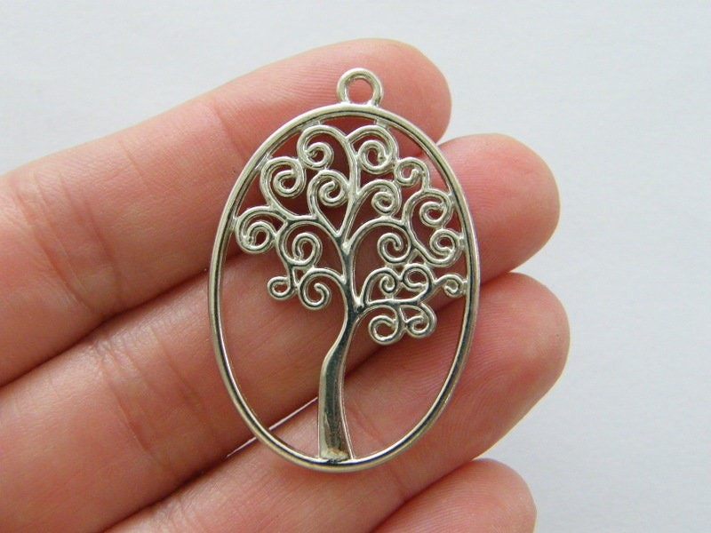 4 Tree charms silver tone T134
