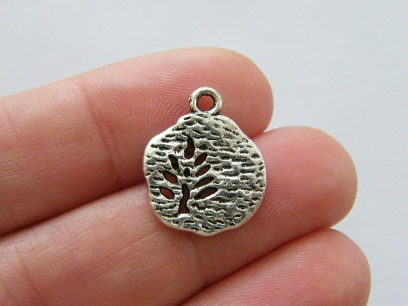 10 Tree charms antique silver tone T135