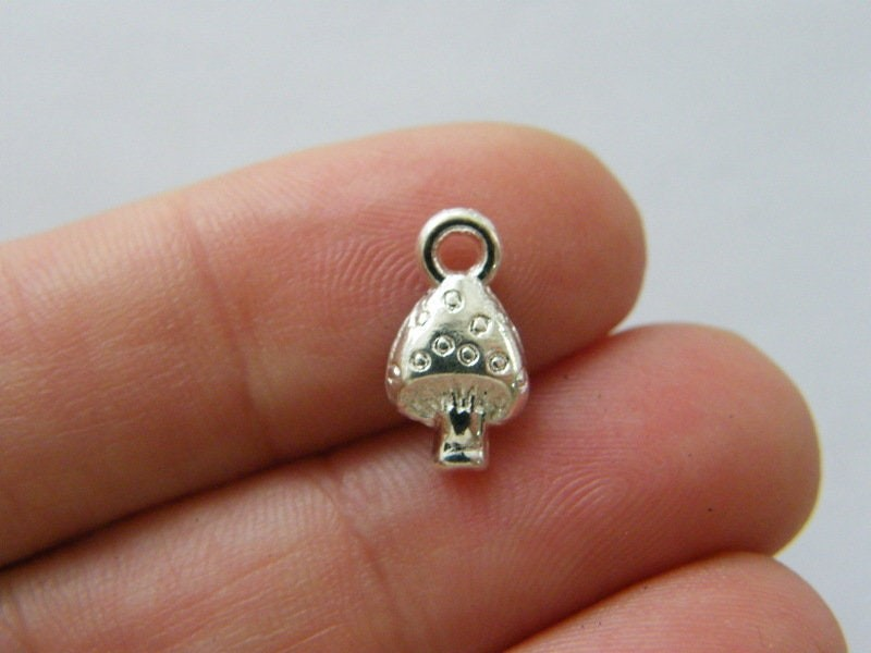 14 Mushroom charms silver plated tone L267