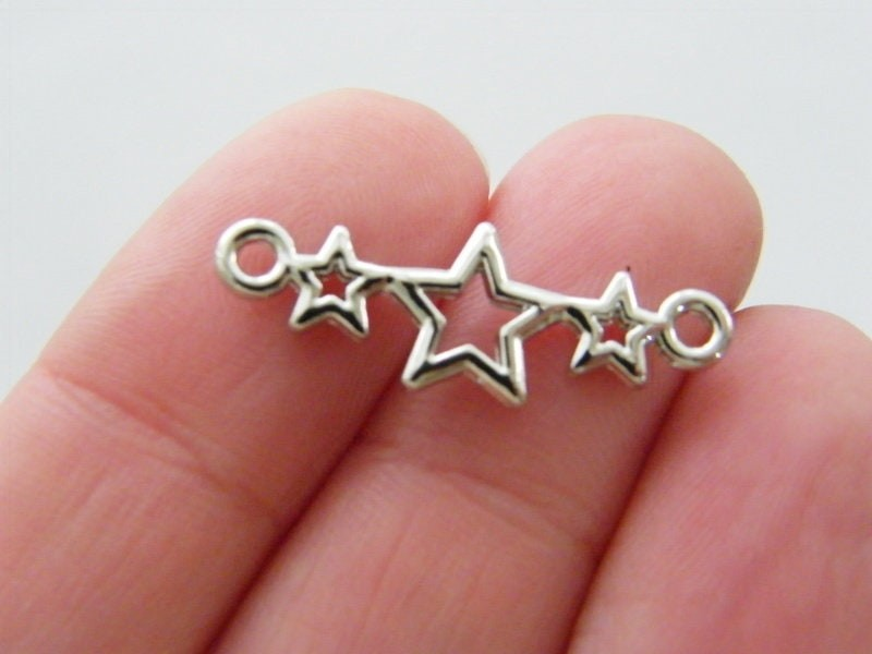 6 Star connectors silver tone S129