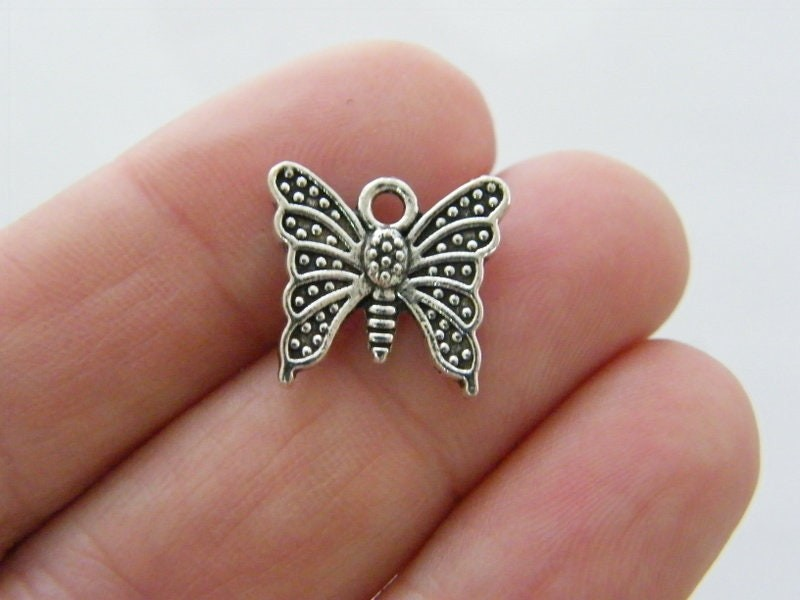 8 Butterfly charms antique silver tone A1052
