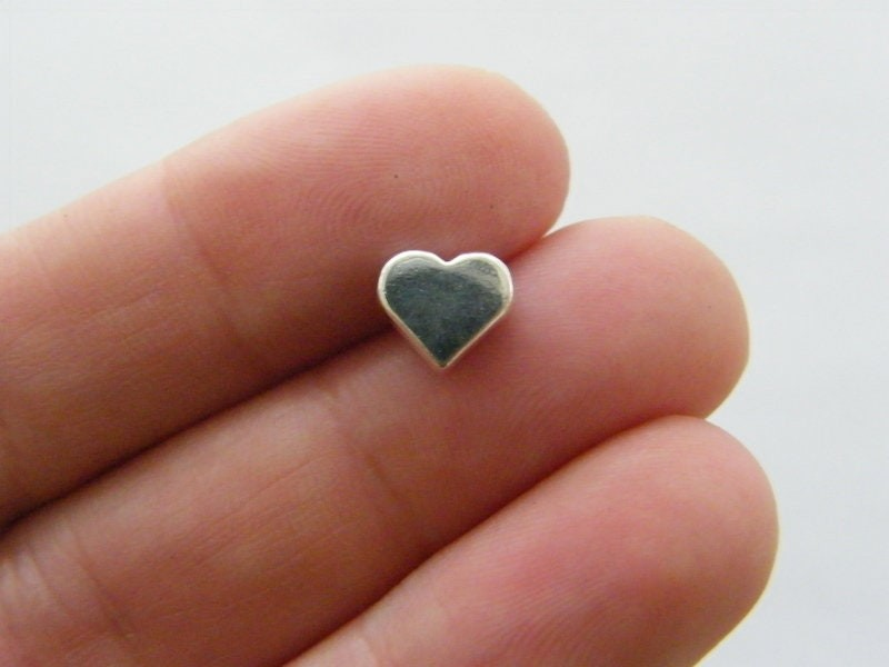 12 Heart spacer beads antique silver tone H33