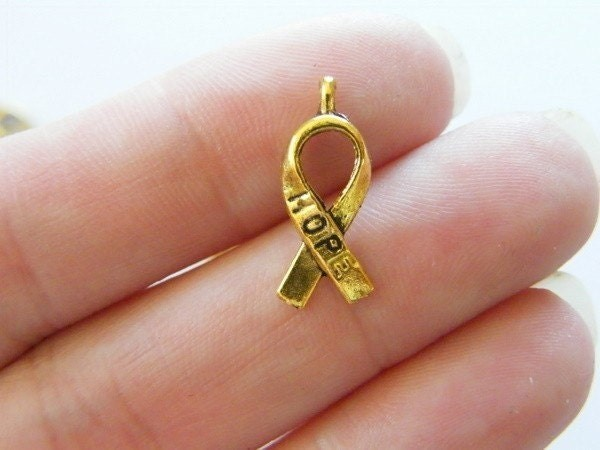 12  Awareness ribbon charms bright gold tone GC3