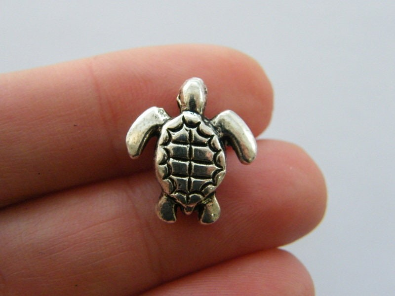 4 Tortoise spacer bead charm antique silver tone FF429