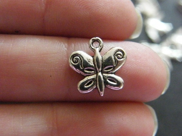 14 Butterfly charms antique silver tone A357