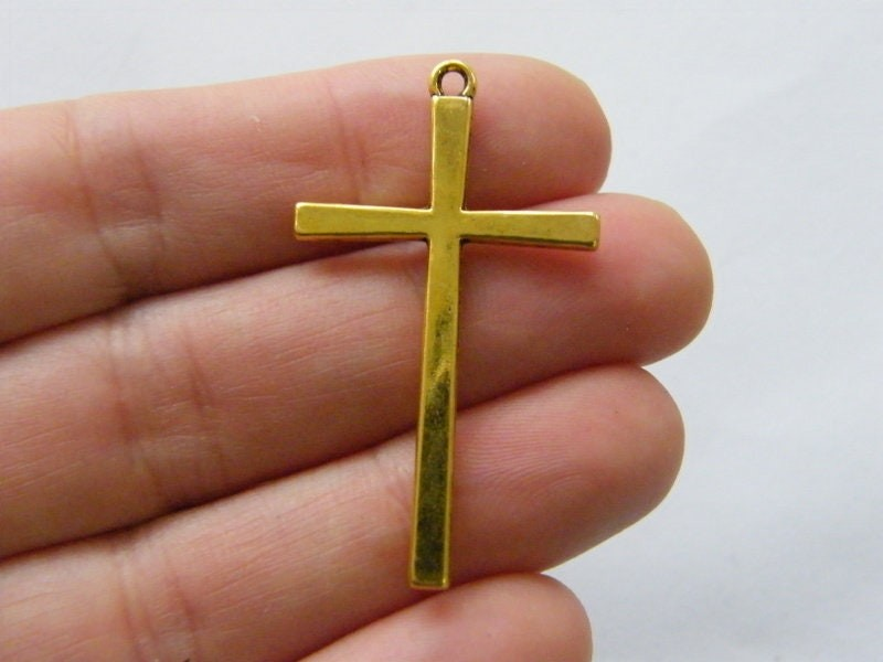 4 Cross charms antique gold tone C81