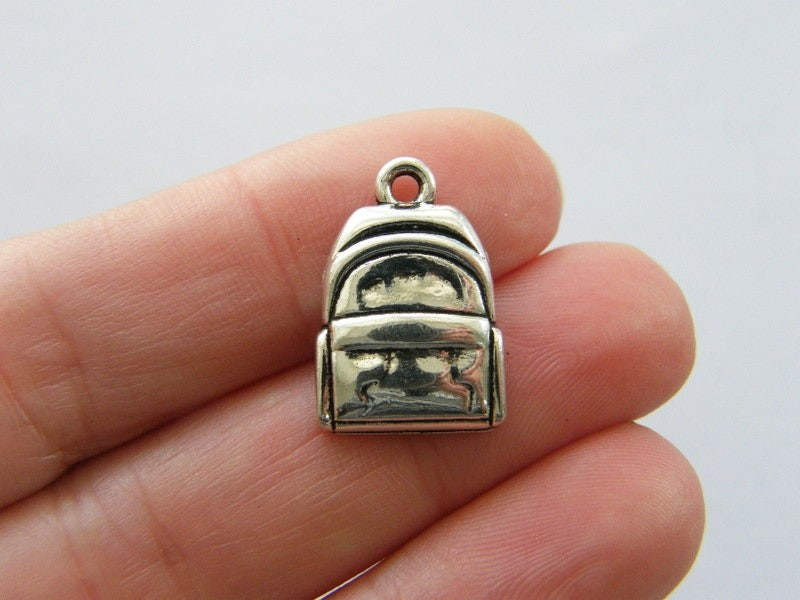 6 Backpack charms antique silver tone CA93