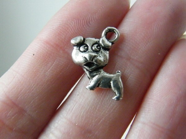 8 Dog charms antique silver tone A787