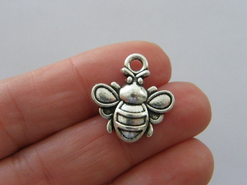 6 Bee charms antique silver tone A1087