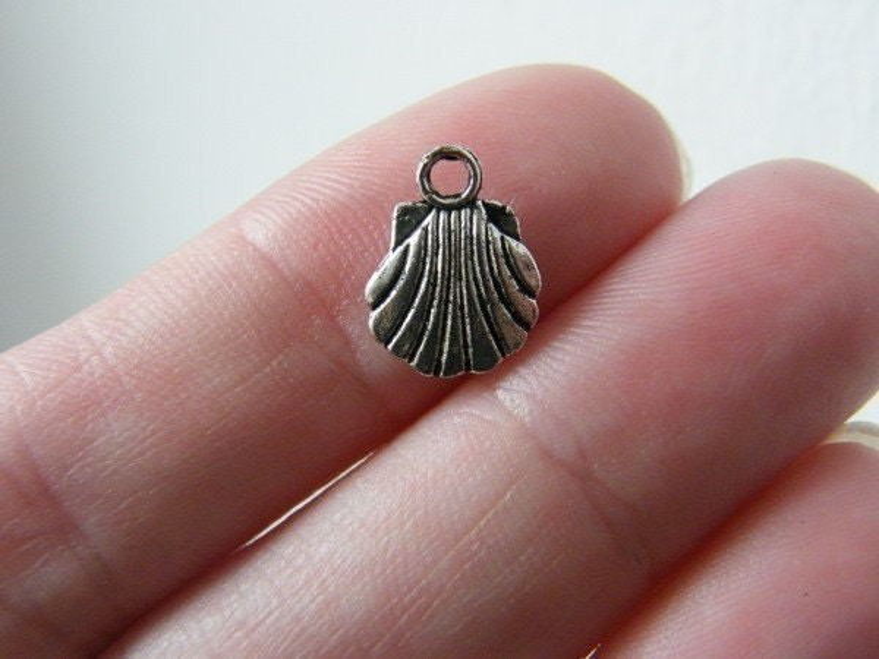 16 Shell charms tibetan silver FF145
