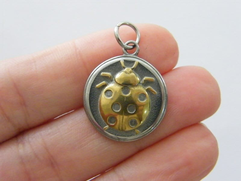 1  Ladybug charm dark silver and gold tone stainless steel A1089