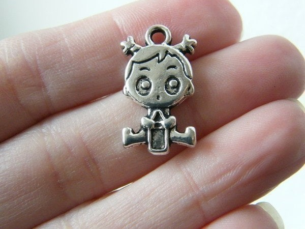 BULK 25 Baby girl charms antique silver tone P566
