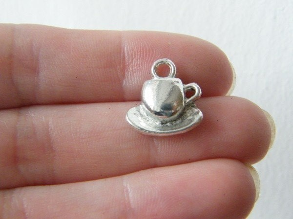8 Cup and saucer charms antique silver tone FD61