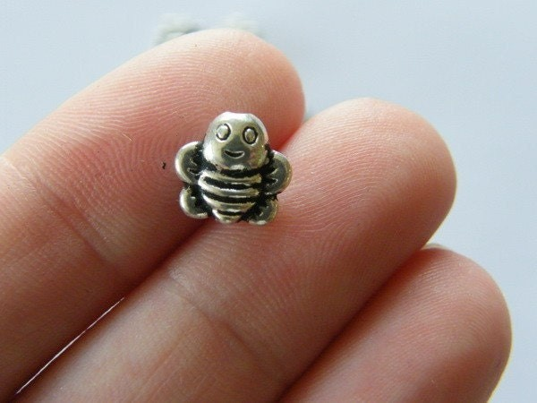 16  Bee spacer beads antique silver tone A302