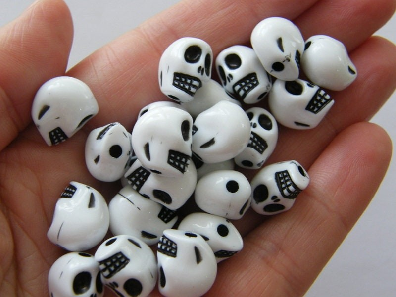 100 Acrylic skull beads white and black acrylic