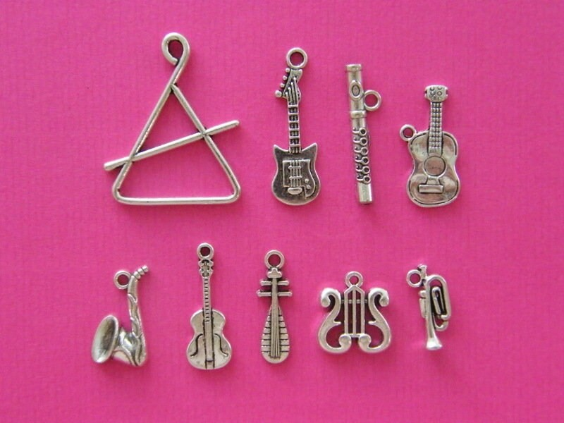 The Musical Instrument Collection - 9 different antique silver tone charms