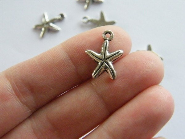 14 Starfish charms antique silver tone FF209