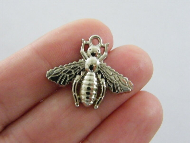 4 Bee charms silver tone A628