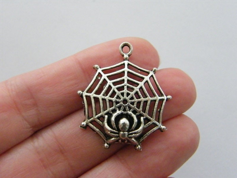 4 Spider in a spiderweb charms antique silver tone HC63