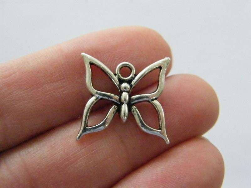 8 Butterfly charms antique silver tone A83