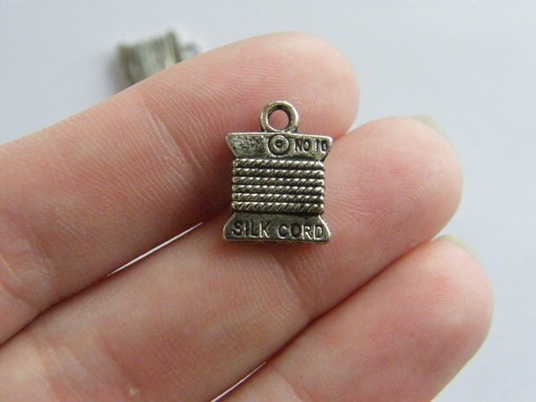 8 Spool  cotton reel thread charms antique silver tone P495