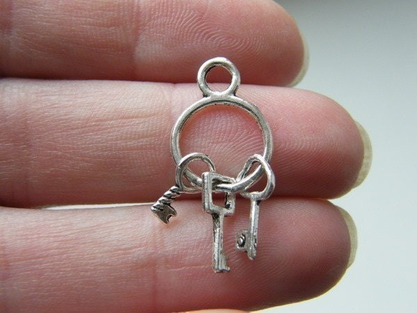 8 Key ring charms antique silver tone K11