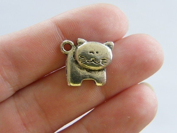 8 Cat charms antique silver tone A869