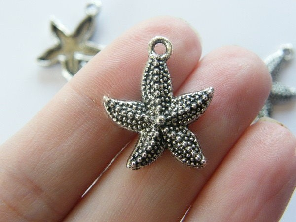 8 Starfish charms antique silver tone FF210
