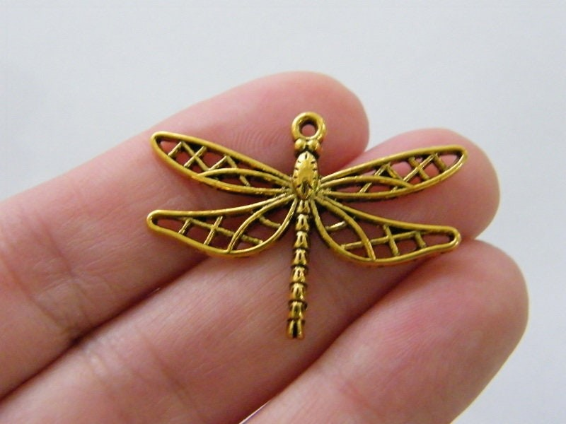 8 Dragonfly charms antique gold tone GC249