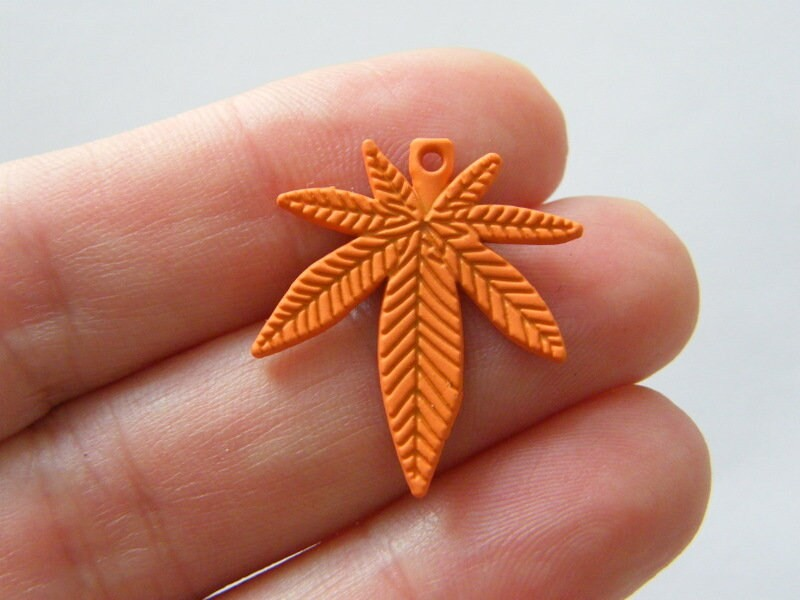 4 Marijuana weed leaf charms orange tone L137