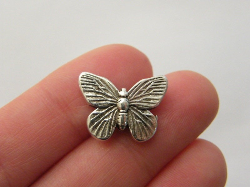 6 Butterfly spacer beads antique silver tone A442