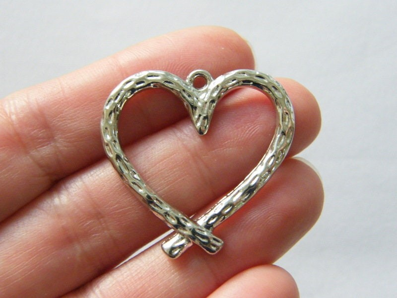 6 Heart pendants silver tone H248