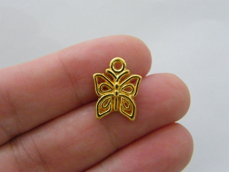 12 Butterfly charms  gold tone GC481