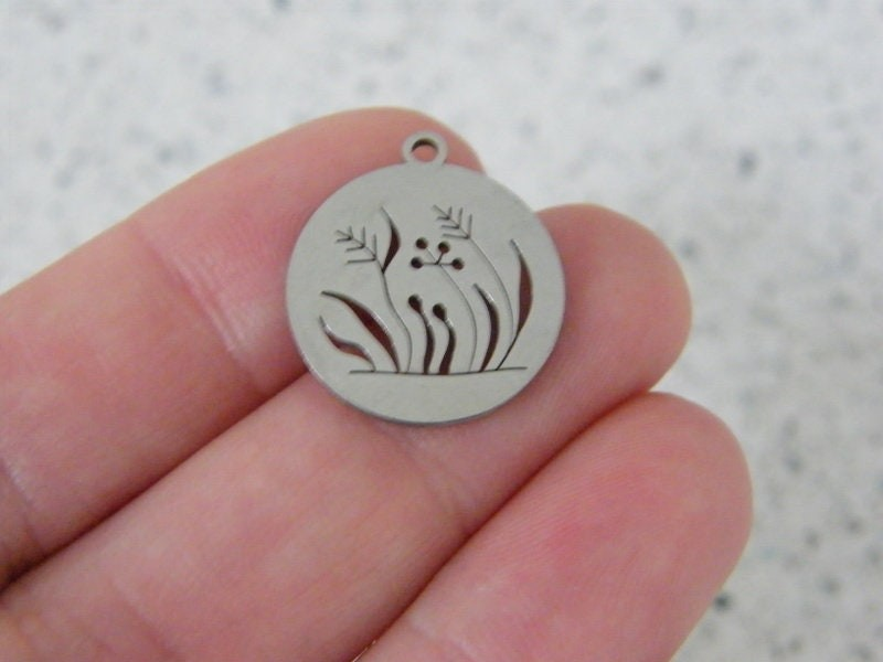 1 Grass cut out pendant silver tone stainless steel L232