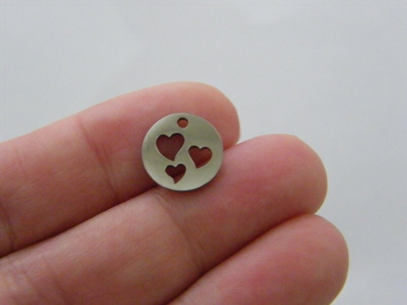 2  Hearts cut out charms silver tone stainless steel H132